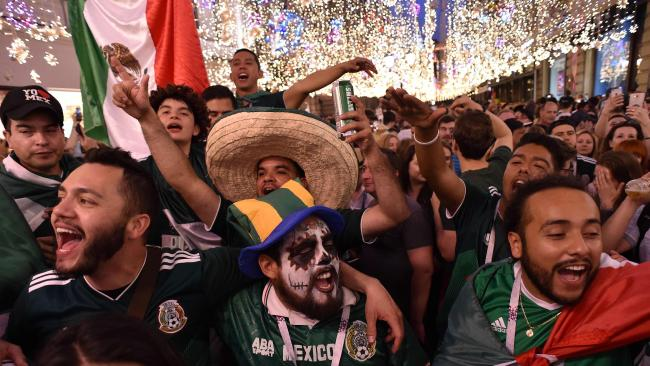 Mexico's national football team fans celebrate their team's victory over Germany outside the Kremlin. Picture:  Vasily Maximov/AFP