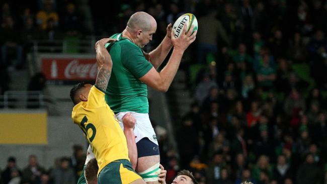 Wallabies fullback Israel Folau loses an aerial challenge against Ireland.