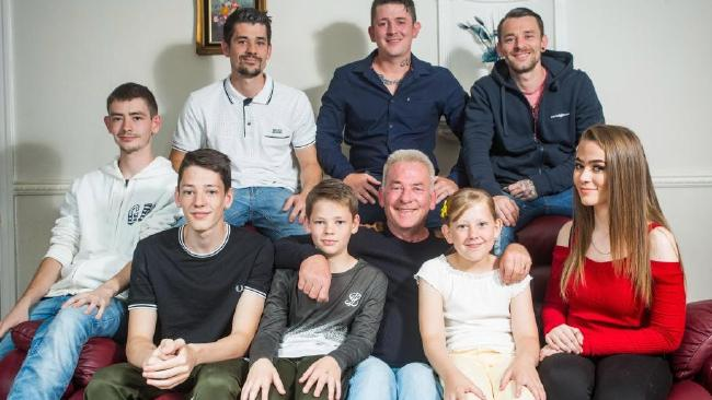 Today Ian Millthorpe, 56, is surrounded by his loving offspring as the clan gather around him to celebrate Father's Day, with wife Angie in their hearts and minds. Picture: SWNS/Mega