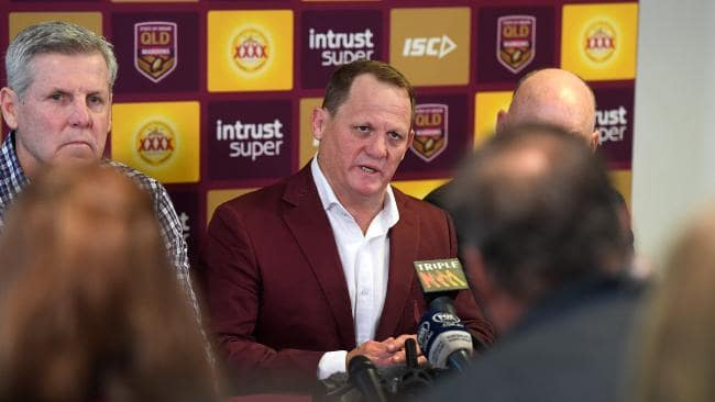 Queensland Maroons coach Kevin Walters (centre), and chairman of selectors Gene Miles speak during a press conference on Monday. (AAP Image/Dan Peled)