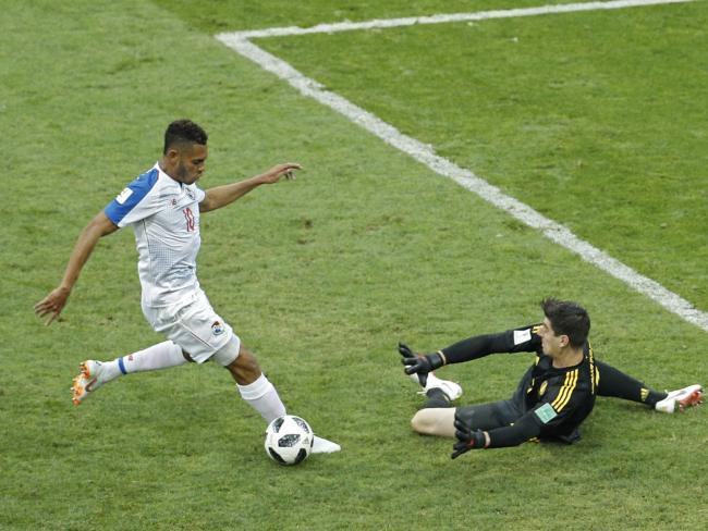 Panama's Ismael Diaz, left, challenges Belgium goalkeeper Thibaut Courtois.