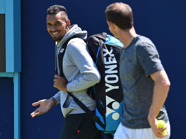 Nick Kyrgios has a laugh with Andy Murray as he practices, ahead of their first round match at the Queen's Club Championships.
