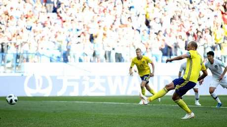 Granqvist slots home the game's only goal. (Clive Brunskill/Getty Images)