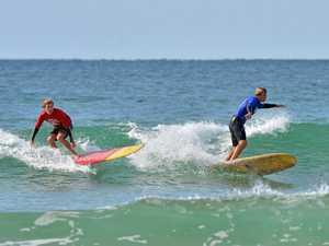SURFING: Winter Longboard Classic. Old Mal. Kai