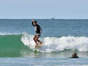 SURFING: Winter Longboard Classic. Old Mal. Tom