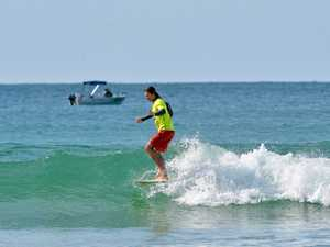 SURFING: Winter Longboard Classic. Old Mal. Cale
