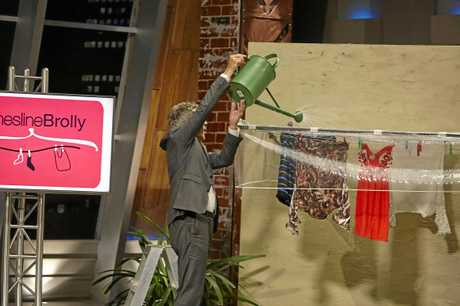Shark Tank's Andrew Banks tests out Liana Wynne's Clothesline Brolly.