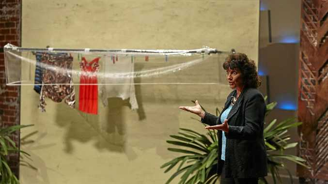 WATER TEST: Liana Wynne on  Shark Tank  where she sought an investor for the Clothesline Brolly. (INSET) Investor Andrew Banks tests out Liana's product.