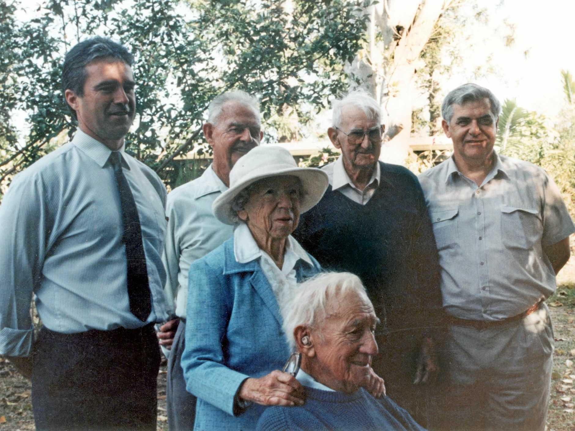 Group of descendants of Sunshine Coast pioneers gathered at Yandina, 1994. Taken in the grounds of ' Koongalba', the Low/Blyth family residence at Yandina. Pictured (back row) L to R: Frank Carroll, Fred Fink, Jack Ferris and John Low.  Foreground: Sybil Vise and Rollo Petrie. .Please note: These images are supplied for use only in connection with the Backward Glance series (both print and online). They are not to be saved or used for other purposes.