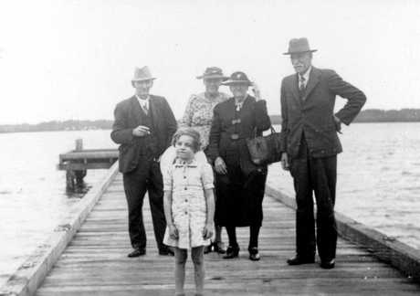 Landsborough Shire Councillor William S. Burgess with family members at Military Jetty, Golden Beach, ca 1940.
