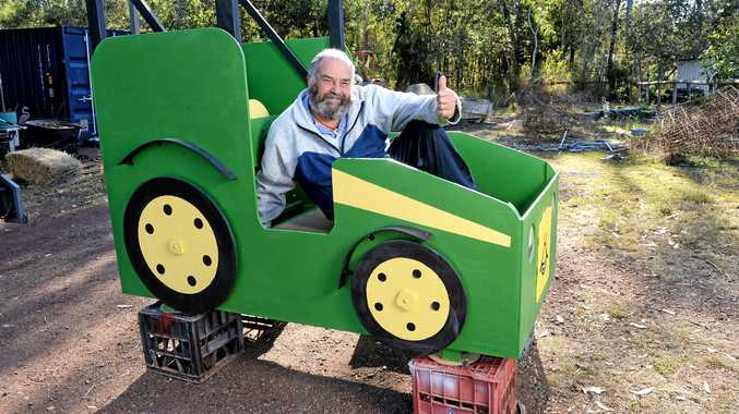WANT THIS BED?: Peter Wark from Ironbark Pete's Beds and Cubby Houses with the tractor bed he has donated to be raffled off this Sunday for a charity bike ride.