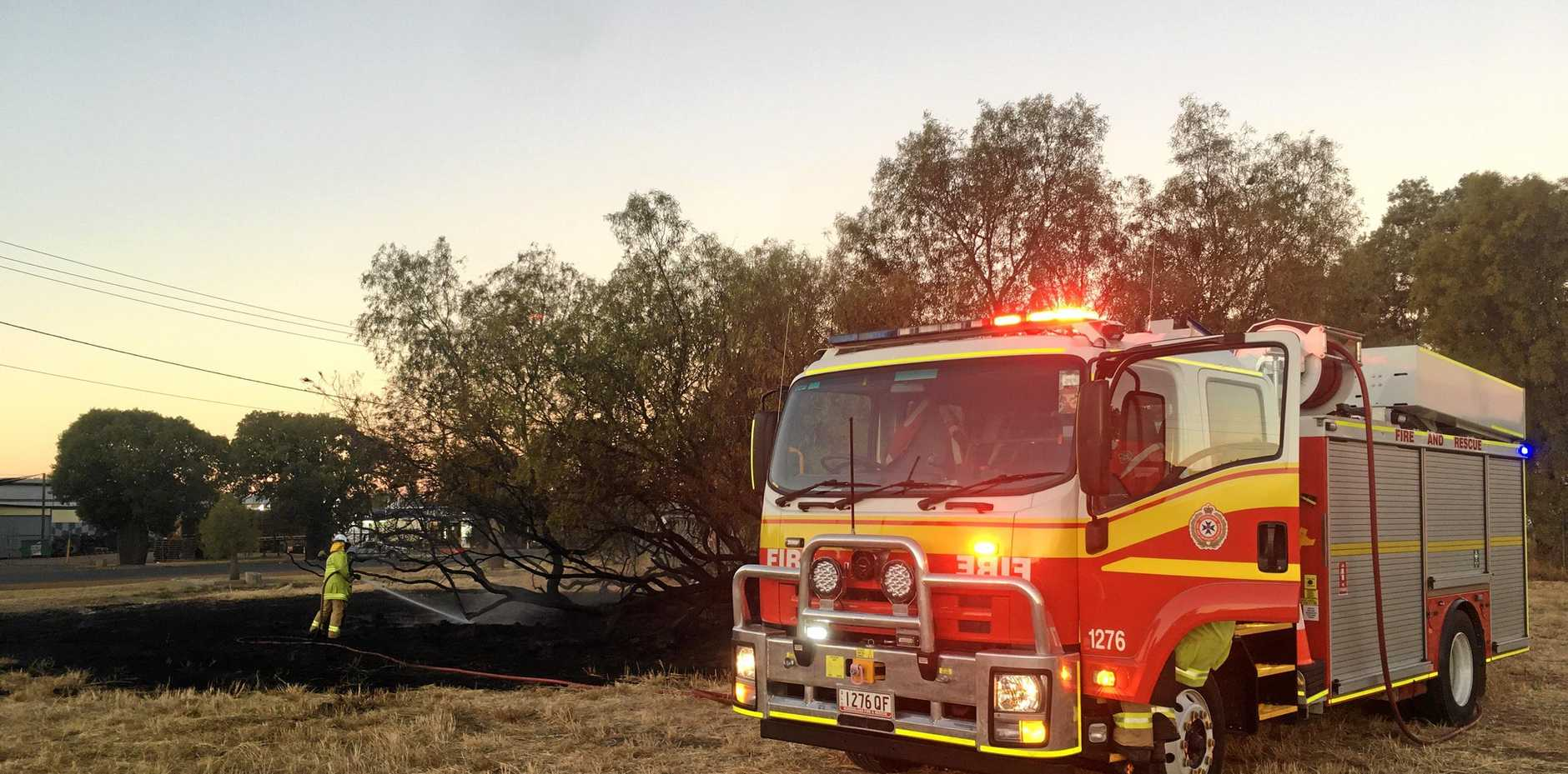 Fire fighters on the scene of a small bush blaze on Wyndham St, Roma.