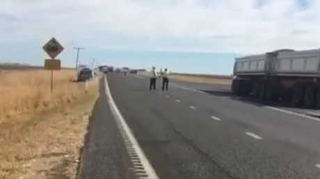 The scene of the crash on the Warrego Highway west of Dalby.