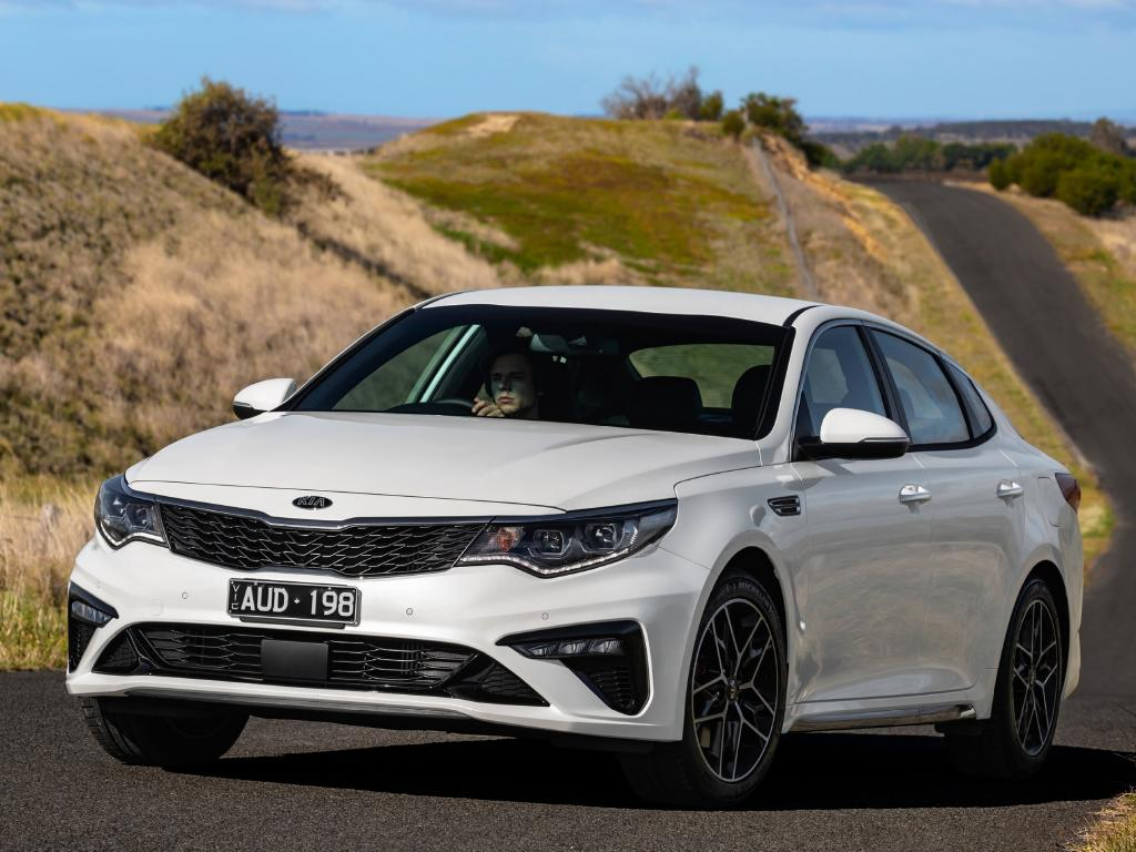 Kia has trimmed the price of the Optima mid-size sedan by $1100-$1200
