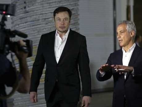 Tesla CEO and founder of the Boring Company Elon Musk, left, and Chicago Mayor Rahm Emanuel arrive at a news conference, Thursday, June 14, 2018, in Chicago. The Boring Company has been selected to build a high-speed underground transportation system that it says will whisk passengers from downtown Chicago to O'Hare International Airport in mere minutes. Picture: Kiichiro Sato