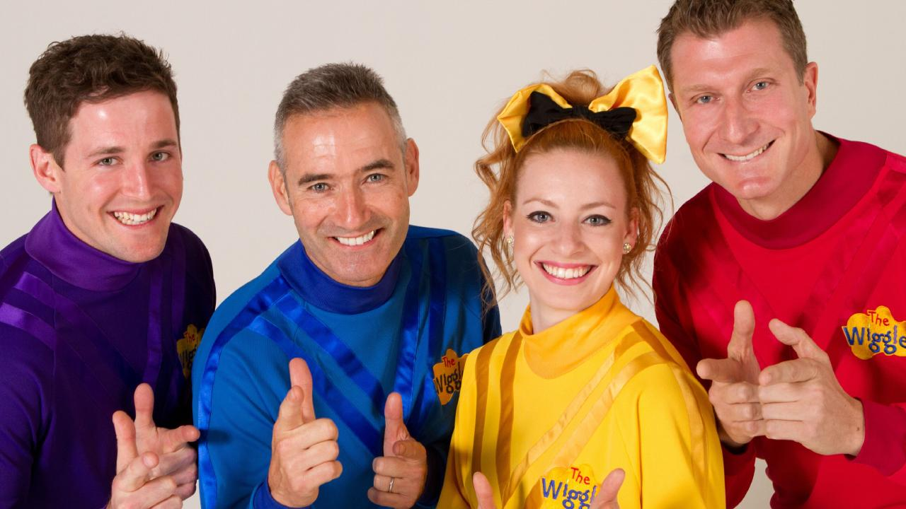 Flashback to 2012 … Original blue Wiggle Anthony Field with Lachlan Gillespie (purple), Emma Watkins (yellow) and Simon Pryce (red).