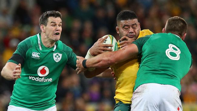 Tolu Latu of the Wallabies is tackled by CJ Stander of Ireland.
