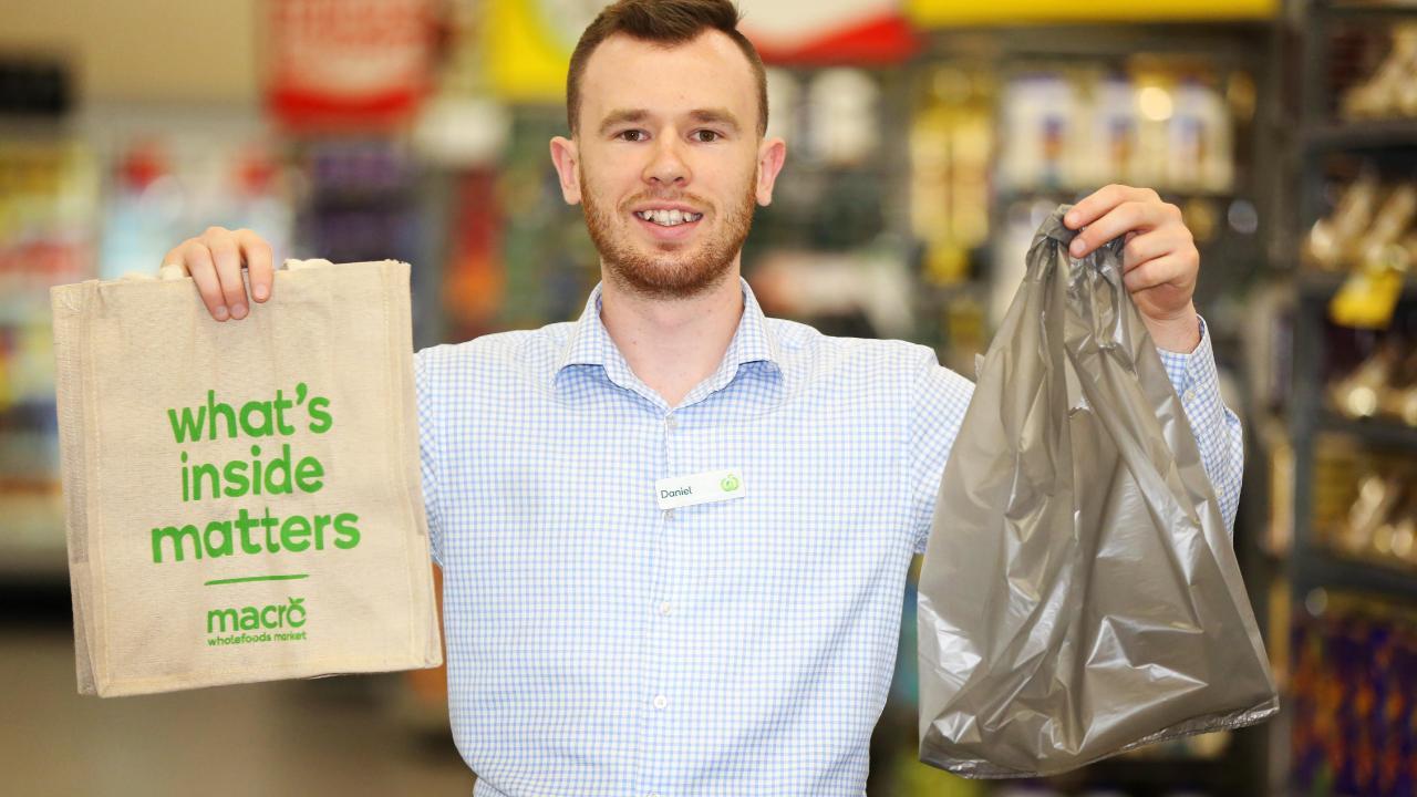 Woolies will ditch plastic bags on 20 June, Coles on 1 July. Pic: AAP Image / Angelo Velardo.