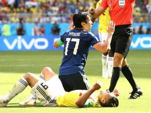 Japan stuns Colombia after early red card
