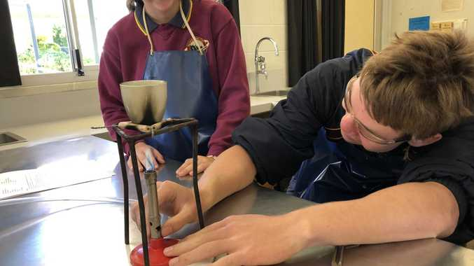 HANDS-ON: Nanango State High School students have a go at building industry experience.