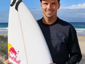 CARVE UP: Julian Wilson relaxes at home at Peregian