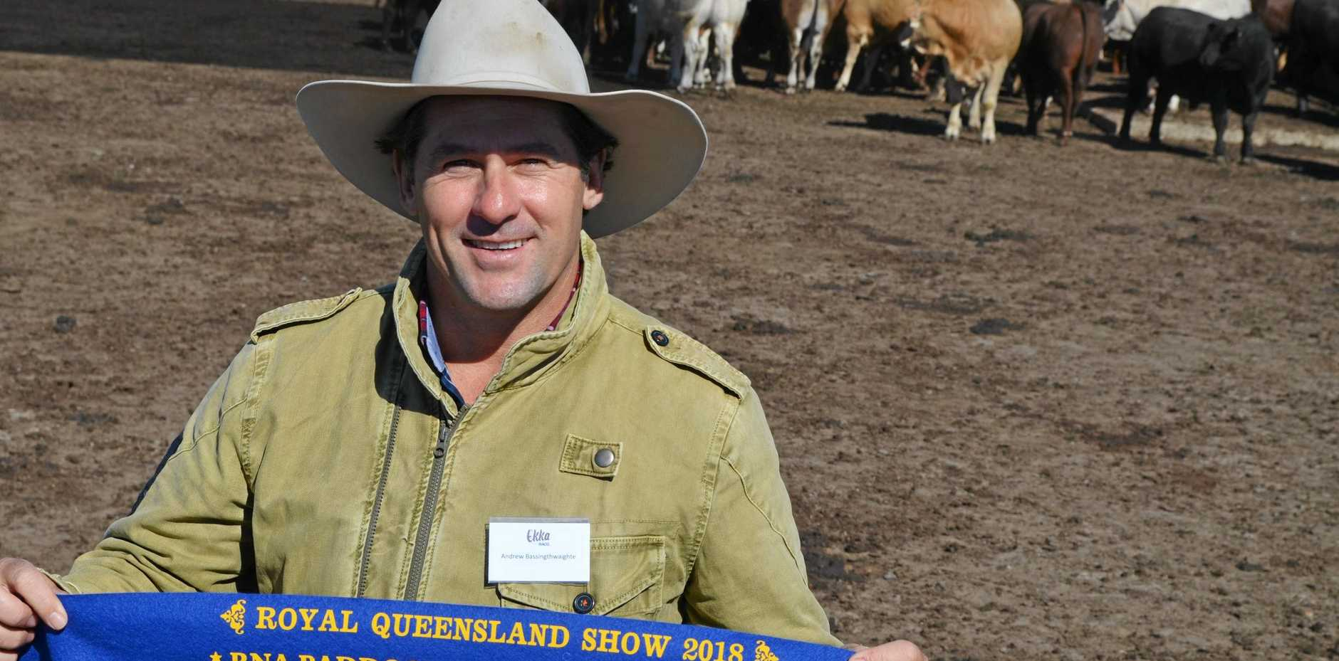 PADDOCK TO PLATE: Wallumbilla's Andrew Bassingthwaighte with one of three ribbons his team picked up.