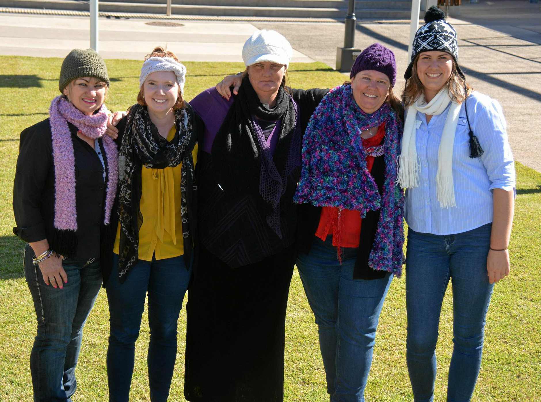 KNITTED GOODS: South Burnett Suicide Prevention Working Group members Andrea McGee, Kirsty Cauley, Kay Swanson, Cr Danita Potter and Rebekah Noe get their knitted goods ready for the Winter Warmers concert on June 22.