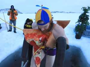'Mad tradition': Aussie expeditioners brave freezing dip