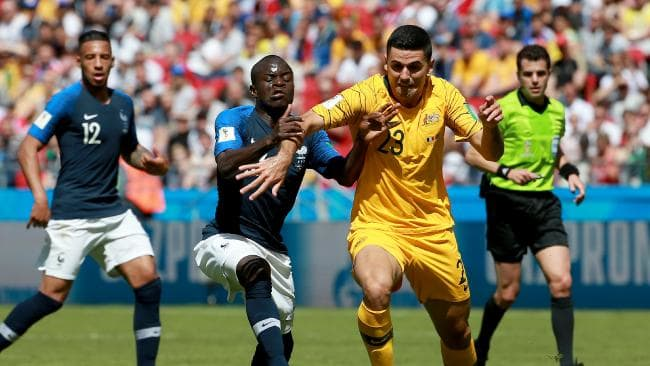 Socceroo Tomas Rogic battles for possession of the ball against France's Ngolo Kante during the Socceroos opening 2018 World Cup match against France at Kazan Arena in Russia. Picture: Toby Zerna
