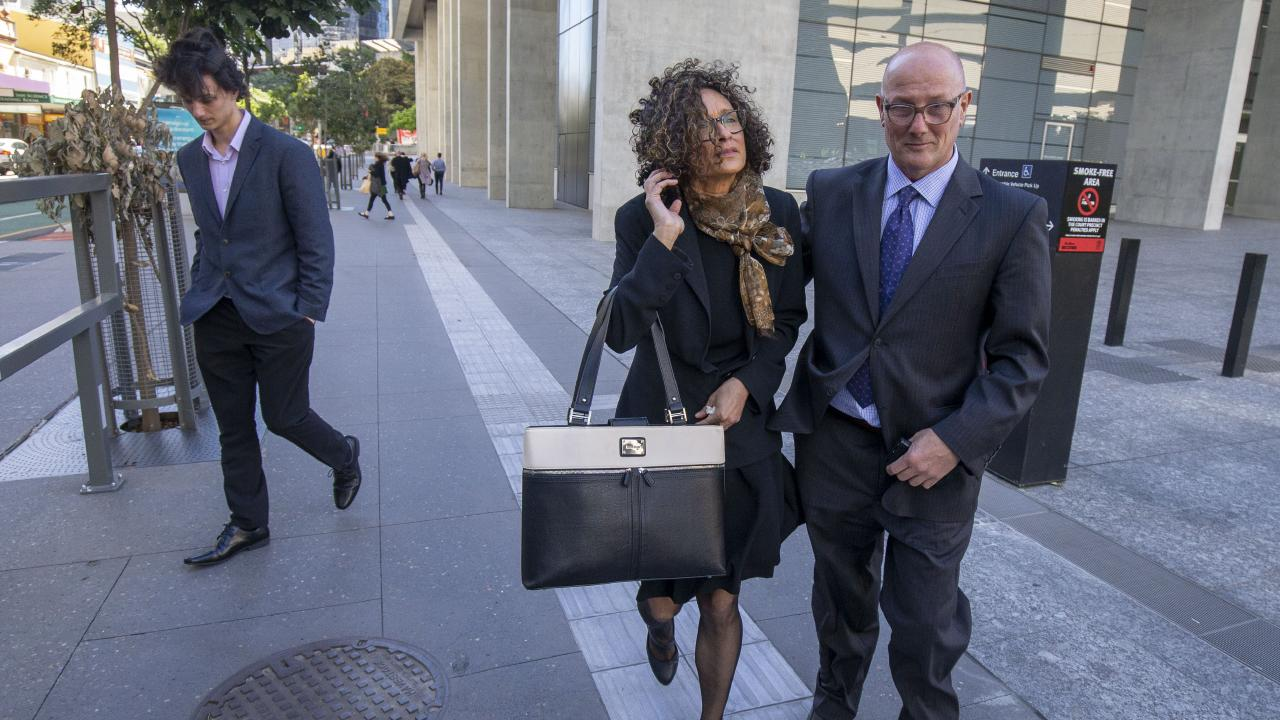Magistrate Catherine Pirie (centre) leaves the District Court in Brisbane with her husband David (right) and son Lachlan (left) on Tuesday. Picture: AAP/Glenn Hunt