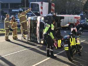 Flipped ambulance was on way to mum giving birth
