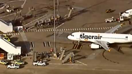 The flight was met by ambulances and fire crews on the tarmac. Picture: 7 News Brisbane