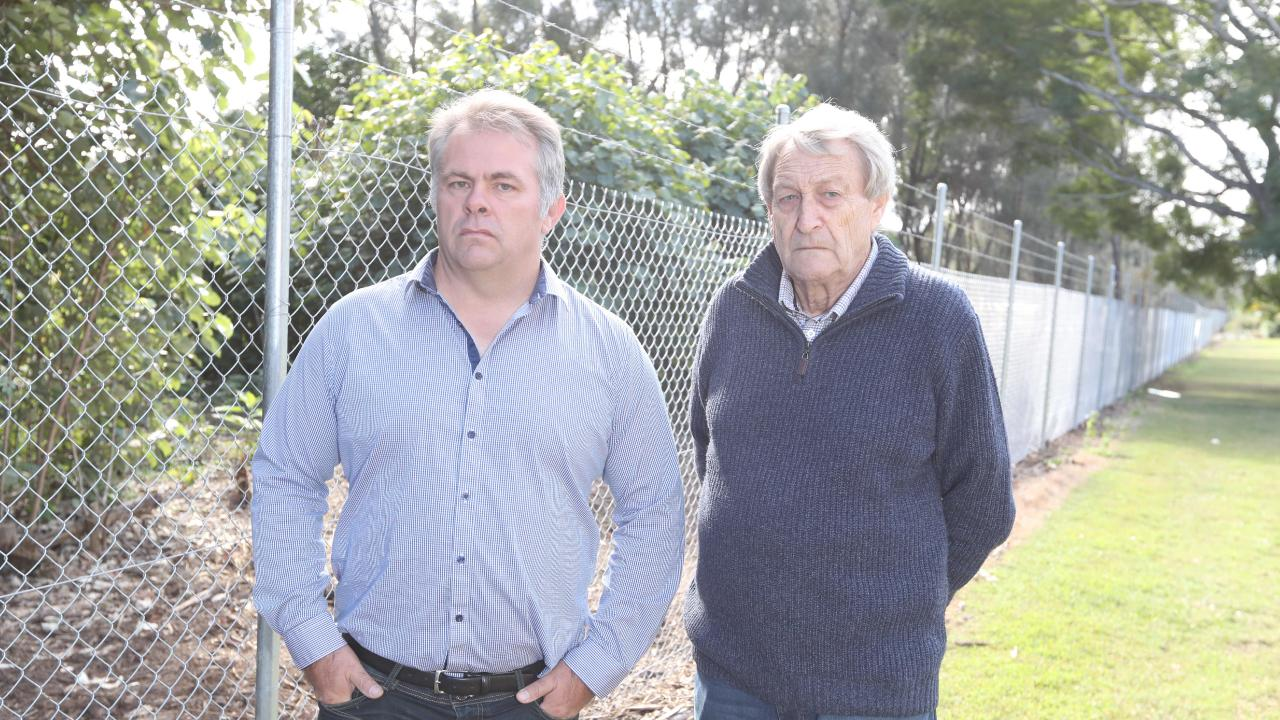 Residents Jason Buchanan and Peter Howe are not happy with the new fence. Photo by Richard Gosling