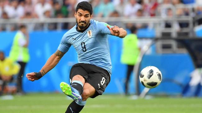 Uruguay's forward Luis Suarez shoots during the Russia 2018 World Cup Group A football match between Uruguay and Saudi Arabia at the Rostov Arena in Rostov-On-Don on June 20, 2018. / AFP PHOTO / Pascal GUYOT / RESTRICTED TO EDITORIAL USE - NO MOBILE PUSH ALERTS/DOWNLOADS
