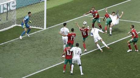 Portugal's Cristiano Ronaldo puts his head to good use against Morocco.