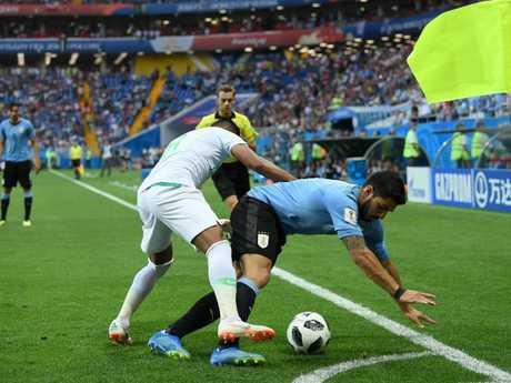 Luis Suarez of Uruguay challenge for the ball with Salem Aldawsari