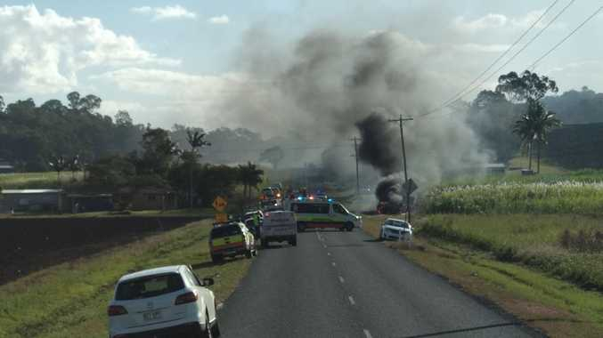 BREAKING: Road closed as car crash fire spreads to cane