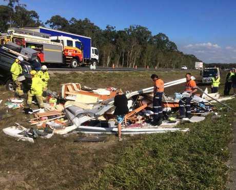 A caravan has flipped on the Bruce Highway at Beerburrum. Via Clayton's Towing.