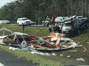Caravan 'flipped' and causes chaos on Bruce Highway