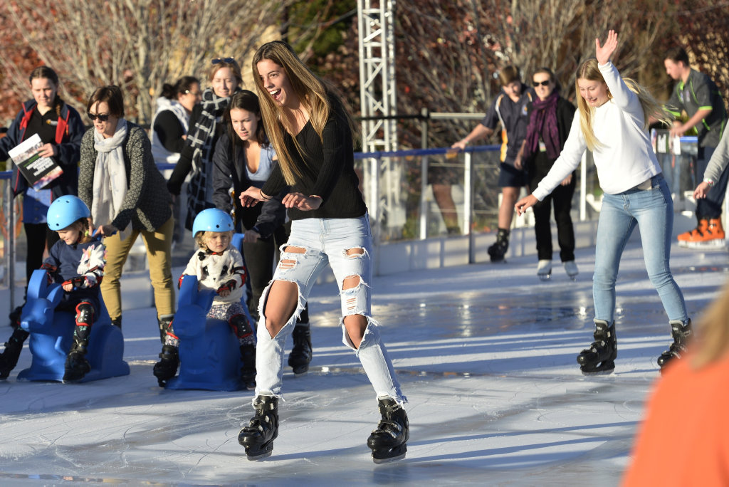 Ava Black (left) and Mykaila Saal ice skating at Winter Wonderland in the Civic Square, Friday, June 22, 2018.