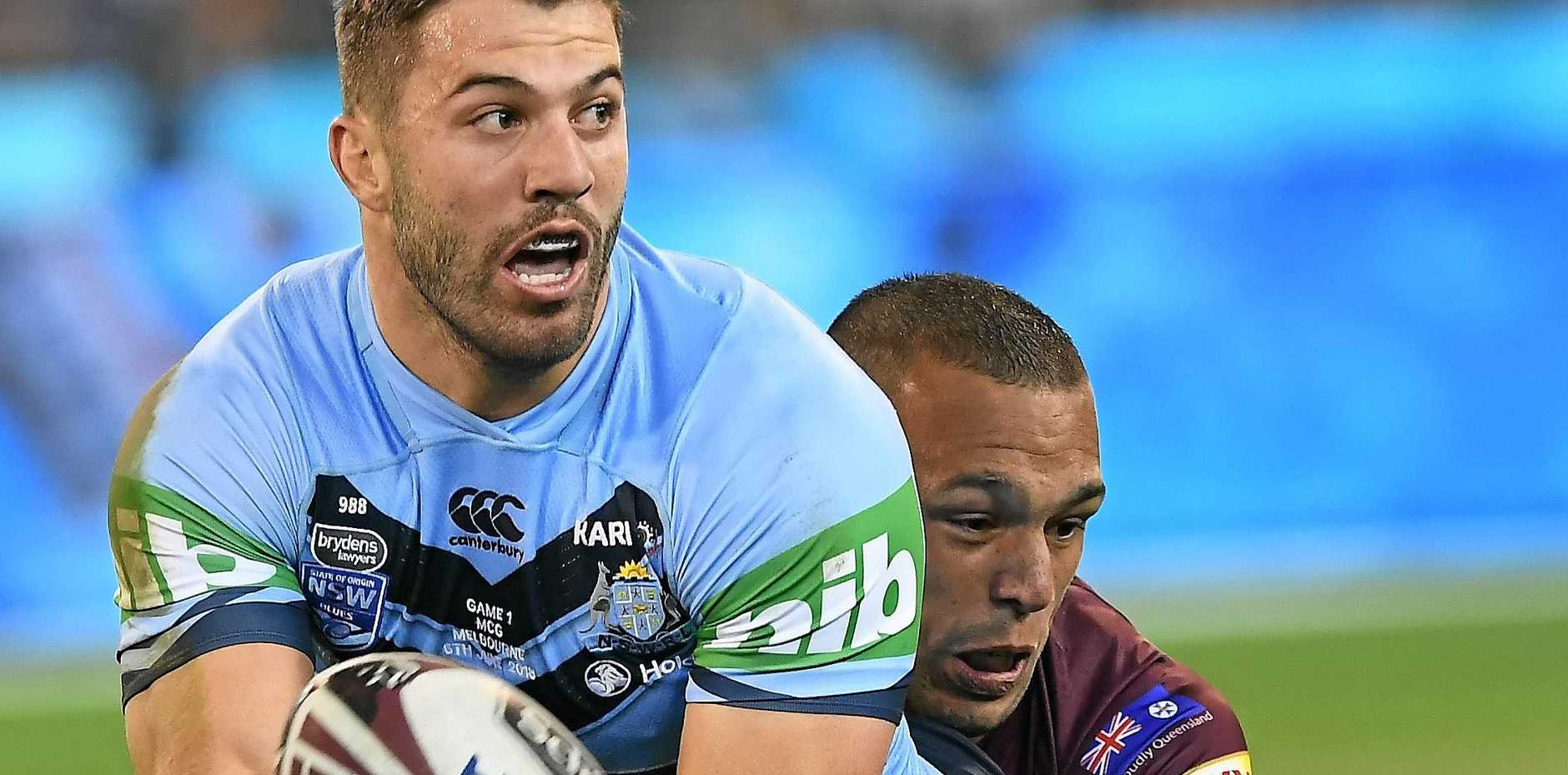GAME ON: James Tedesco of the Blues (left) and Will Chambers of the Maroons are seen in action during Game 1 of the 2018 State of Origin series at the MCG in Melbourne, Wednesday, June 6, 2018.