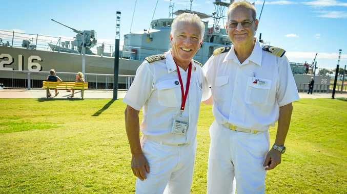 WARM WELCOME: Captain Adriano Binacchi and hotel director (crewman) Duncan Puttock.