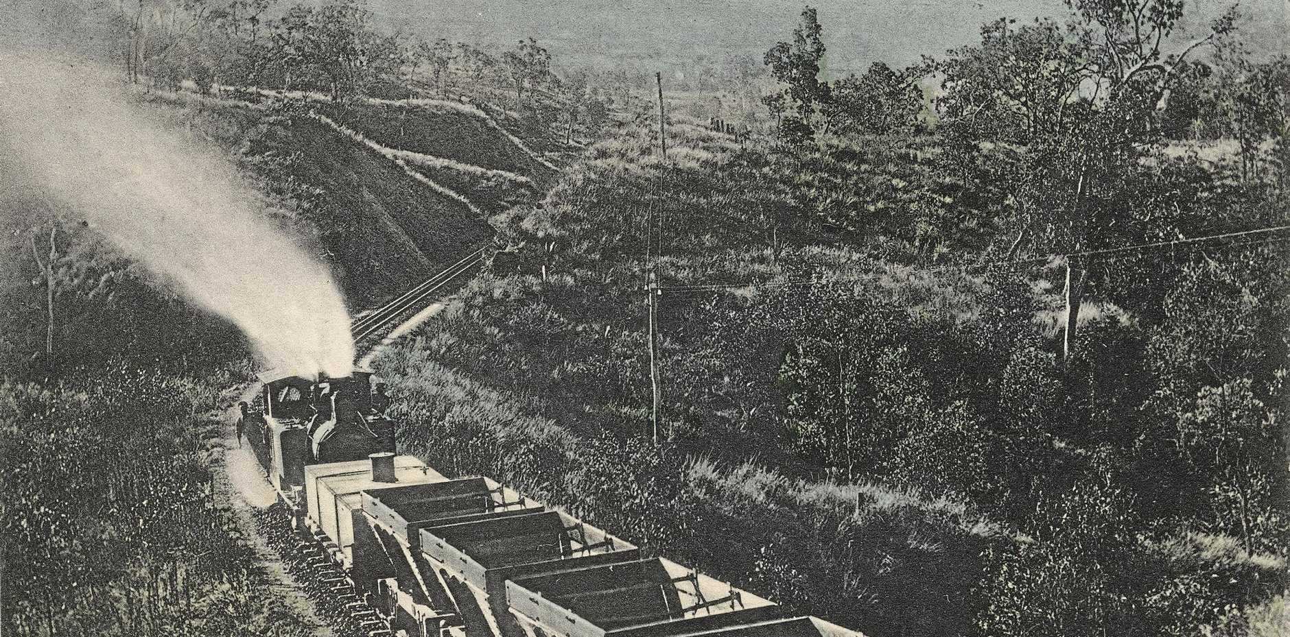 COAL COUNTRY: A locomotive pushes coal wagons up the range to Mount Morgan.