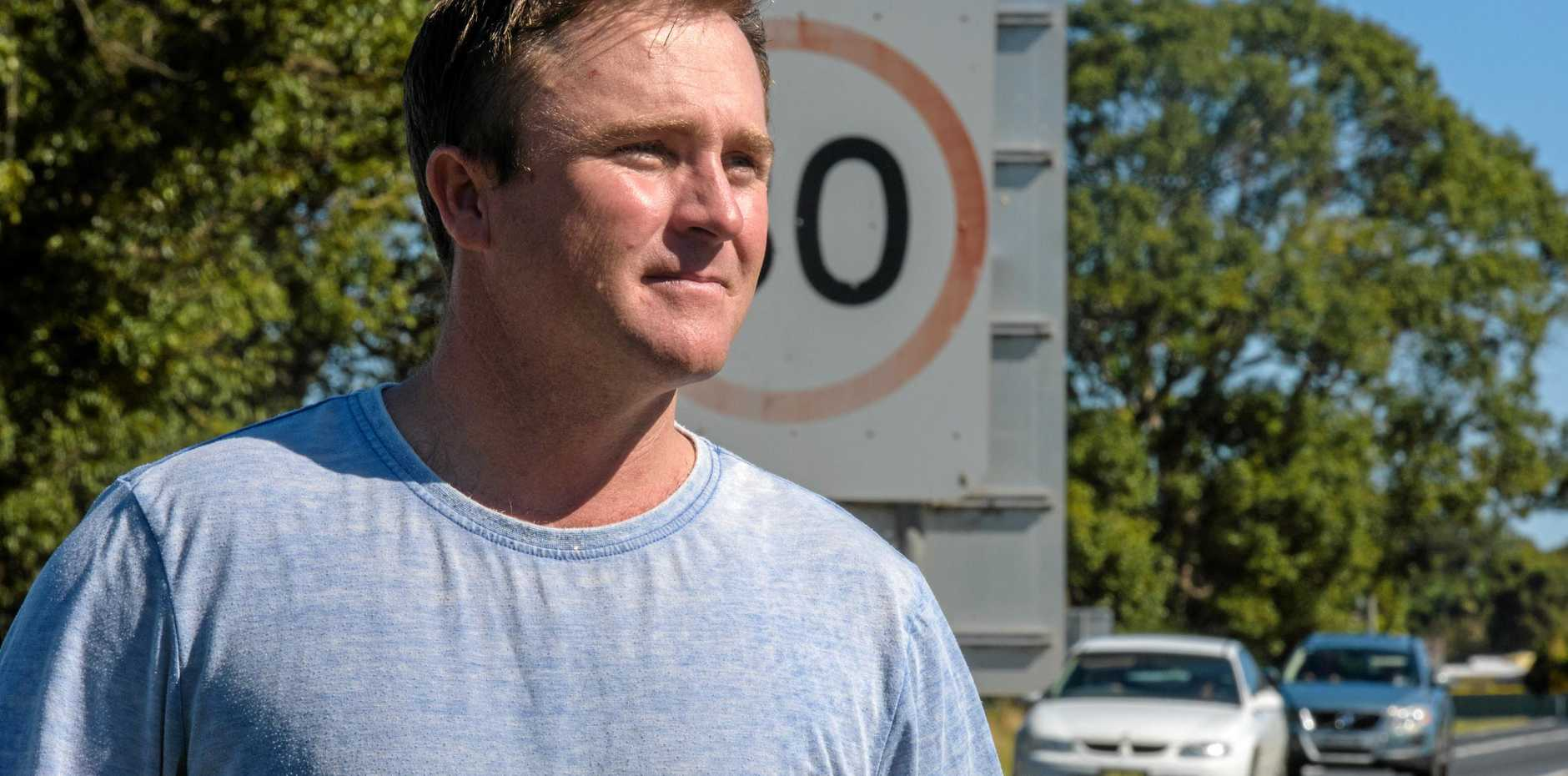 Ryan Brown looks over the speed sign that wil be soon be changed around teh Ulmarra village after campaigning.
