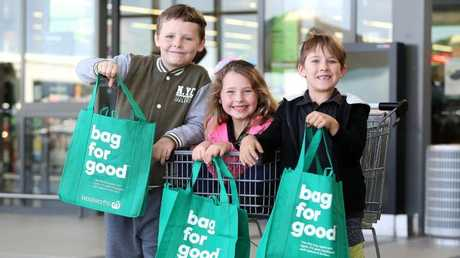 Cooper and Savannah Edgar and Kody Vaneck with their green bags at Woolworths Waterford. Picture: AAP/Jono Searle