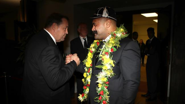 Karl Tu'inukuafe of the All Blacks shakes hands with coach Steve Hansen, left.
