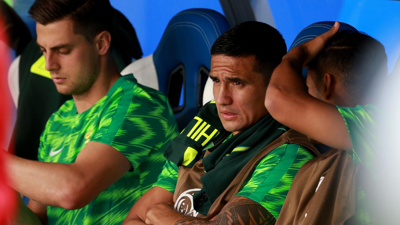 Benched... Tim Cahill watches on during the World Cup match between Australia and Denmark. Picture: Toby Zerna