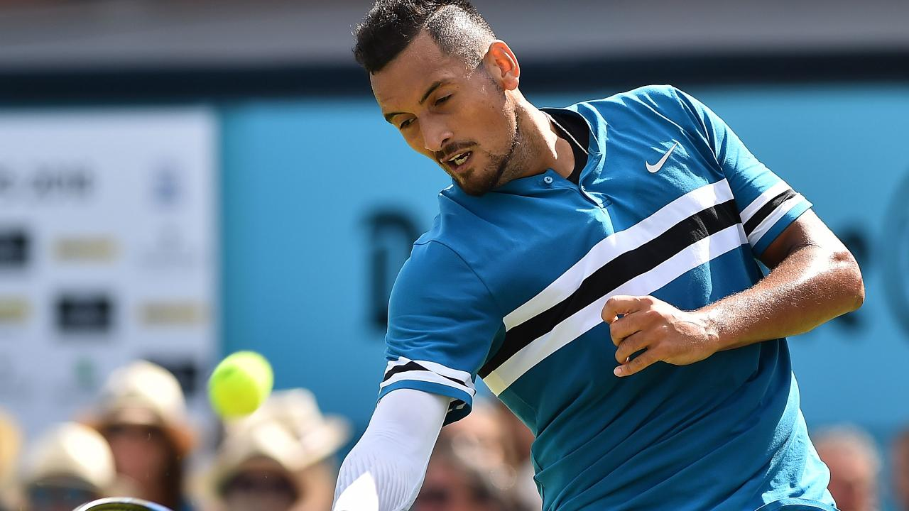 Nick Kyrgios on his way to an ill-tempered victory over Kyle Edmond. / AFP PHOTO / Glyn KIRK