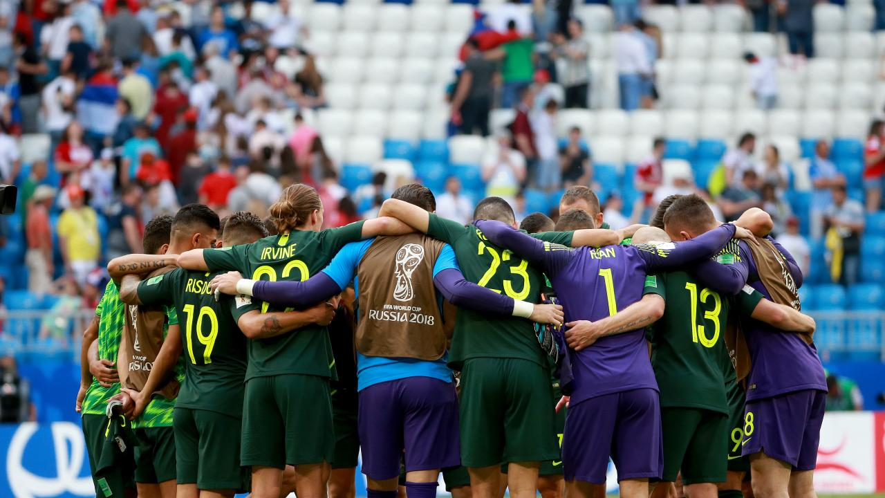 The Socceroos embrace in the middle of the pitch after they drew with Denmark during the World Cup match between Australia and Denmark at Samara Arena, Russia. Picture: Toby Zerna