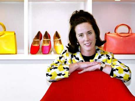 Kate Spade poses with her handbags and shoes in her New York store.  Picture:  AP